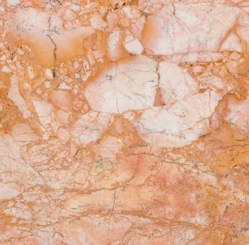 明亮的光滑的棕色大理石纹理装饰墙壁的 库存照片