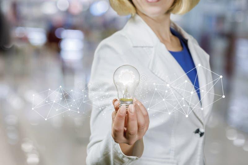 明亮的创新想法手中女实业家 库存照片