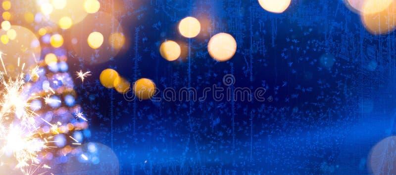 明亮的圣诞节;蓝色Xmas假日背景 库存图片
