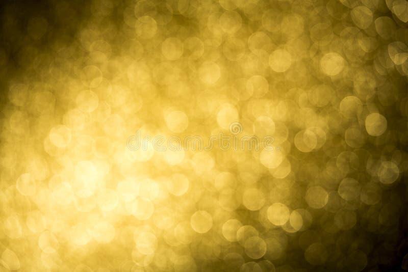 明亮的未聚焦的金摘要bokeh背景 免版税库存照片