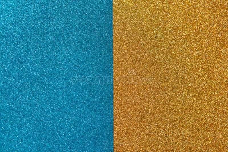 明亮的欢乐精采背景,包括两一半、蓝色和金子 ?? r 免版税库存图片