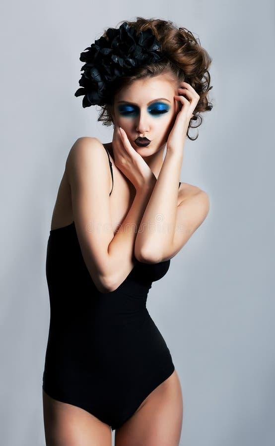 明亮的淫荡性感性感的vamp妇女 库存照片