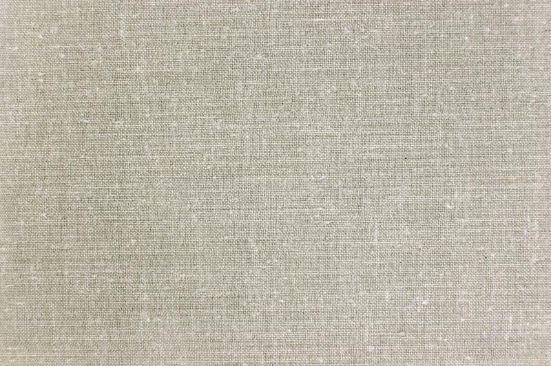明亮的灰色亚麻制纹理,大详细的宏观特写镜头,水平的织地不很细样式背景 图库摄影