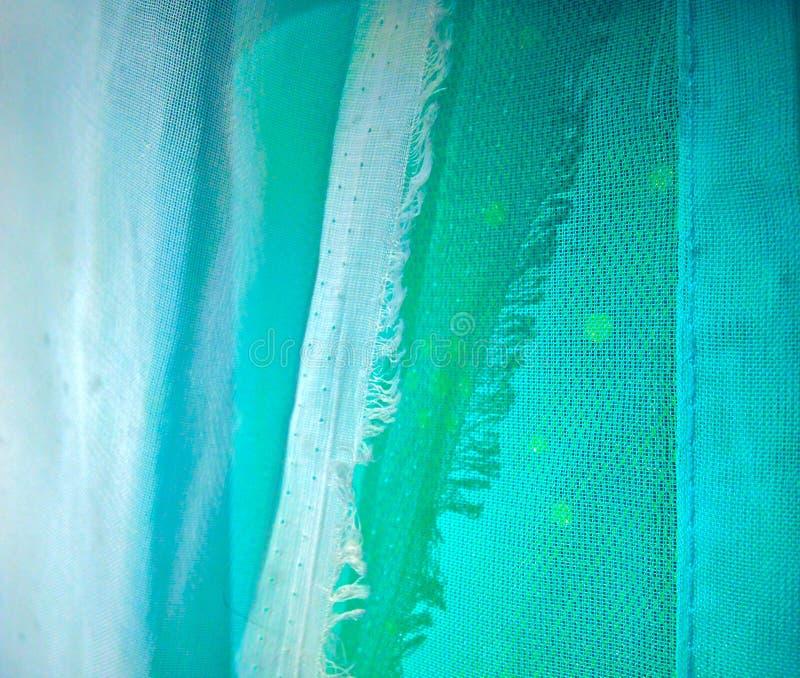 明亮的蓝色绿松石纺织品背景 免版税库存图片