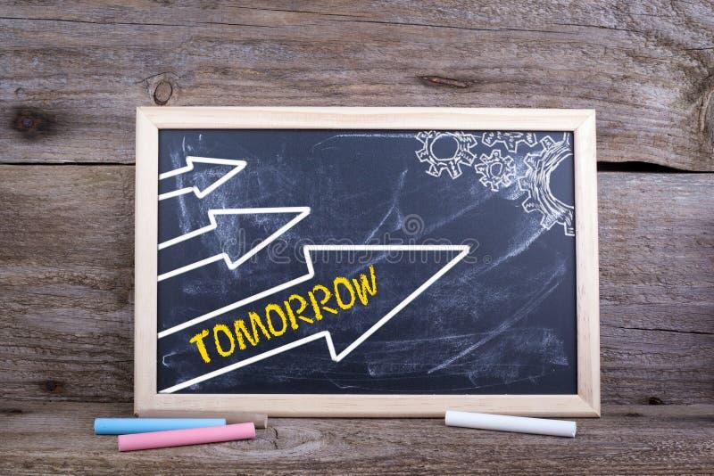 明天 与纹理和白垩黑板的老木背景 库存照片