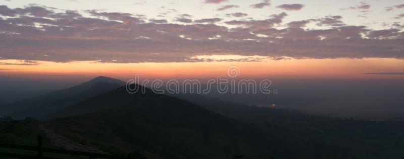黎明日出在高峰区 免版税库存图片