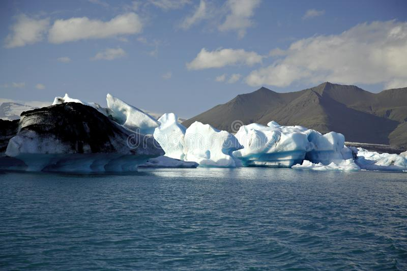 星期日点燃的冰山 免版税库存图片
