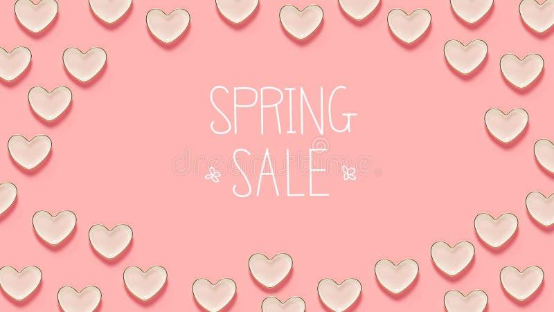 春天与许多心脏盘的销售消息 库存例证