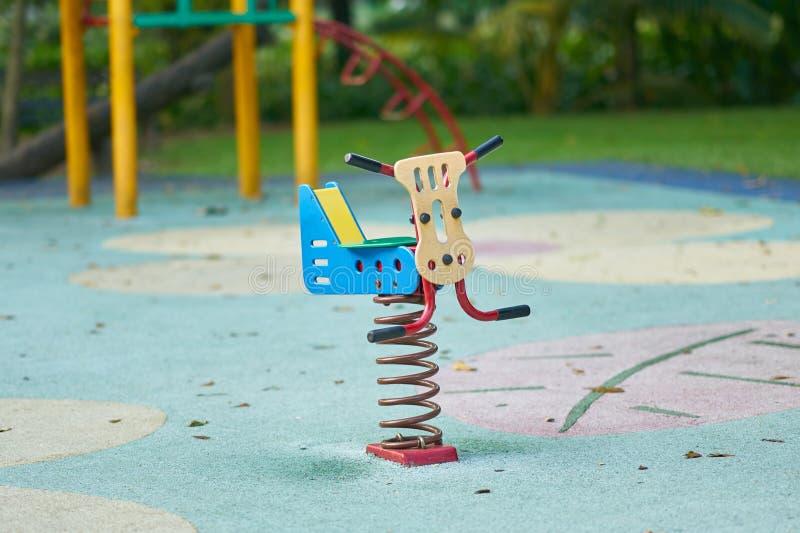 春天跷跷板或玩具在操场 免版税库存图片