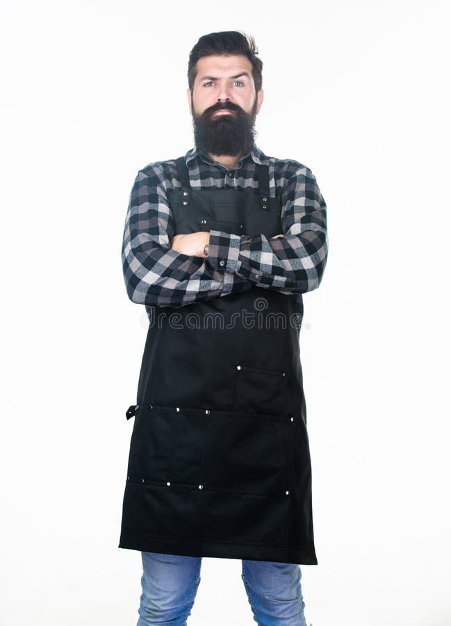 是在严肃的想法丢失了 有严肃的看起来佩带的工作围裙的有胡子的人 有长的胡子和髭的行家 免版税库存图片