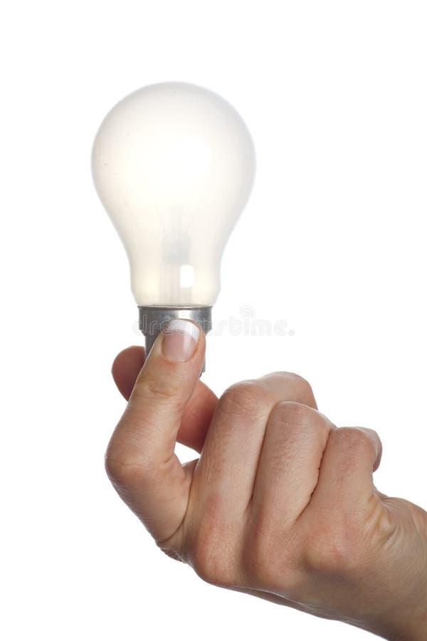 是电灯泡拿着光 免版税库存图片