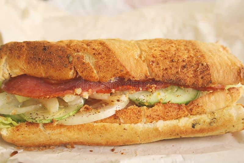 是被吃的英尺长准备好的三明治地铁 免版税库存照片