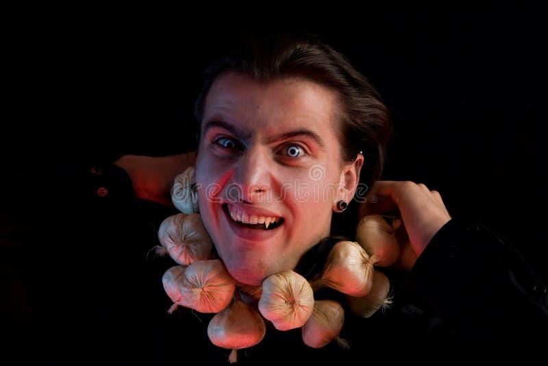 是被堵塞的大蒜被窒息的吸血鬼 免版税库存照片