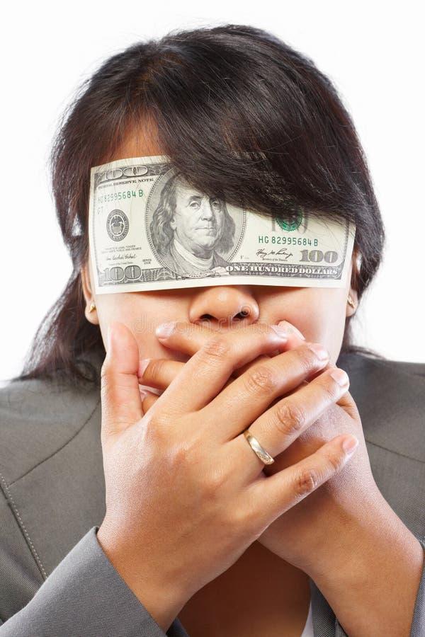 是被蒙蔽的女实业家货币 库存图片