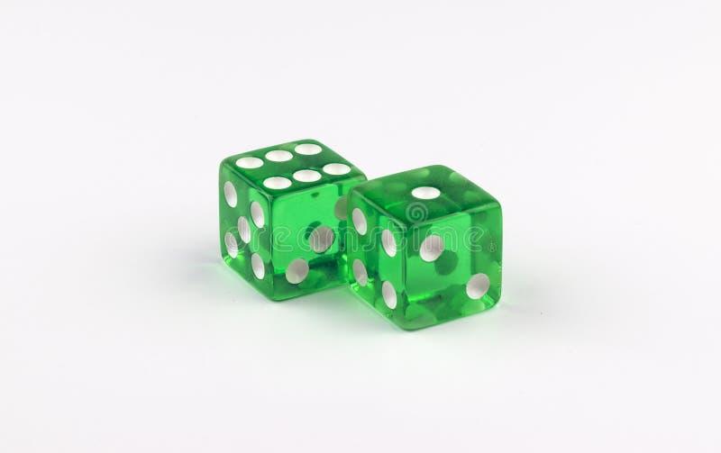 显示七个斑点的一个对绿色,透亮赌博模子 免版税图库摄影
