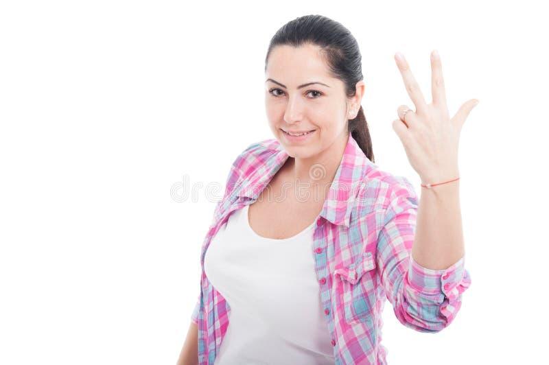 显示三个手指的白种人妇女的图片 图库摄影