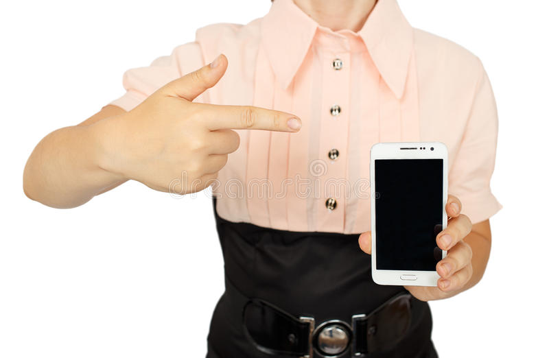 显示与手机黑显示的年轻女商人 免版税库存图片