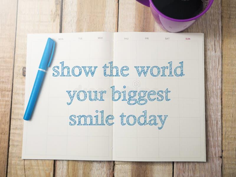 显示世界您的最大的微笑,诱导词行情骗局 免版税库存照片