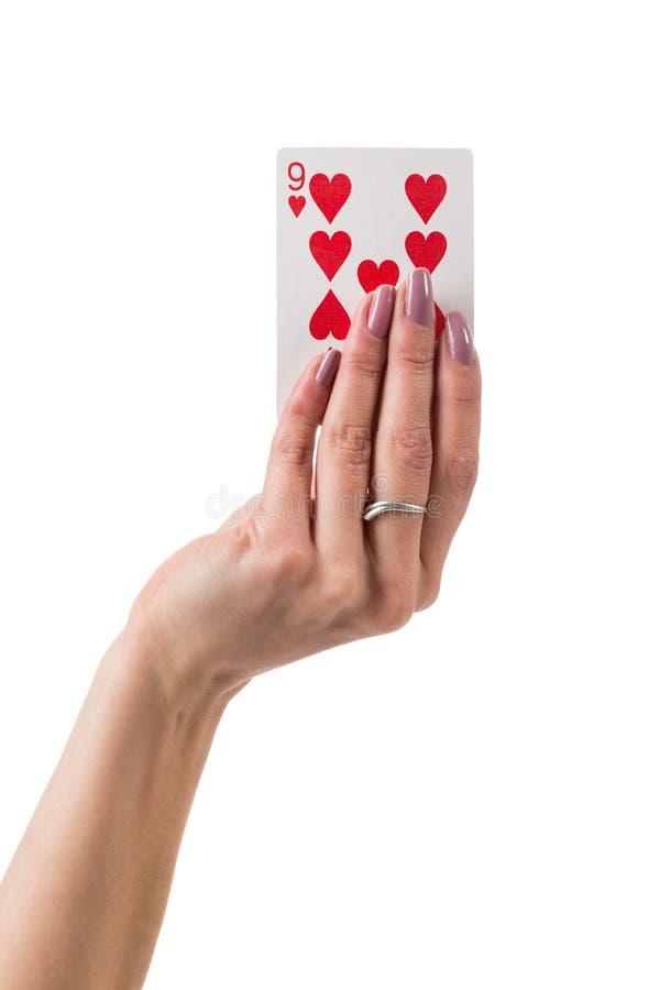 显示九心脏卡片的女性手 免版税图库摄影