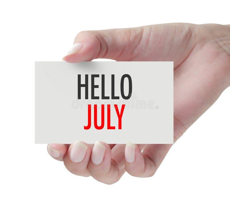显示你好7月的手 免版税库存照片