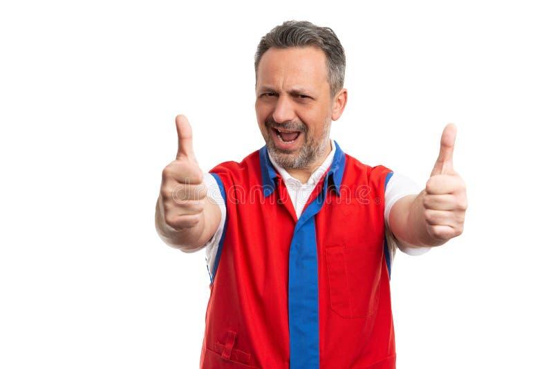 显示双重赞许的超级市场雇员 免版税库存图片