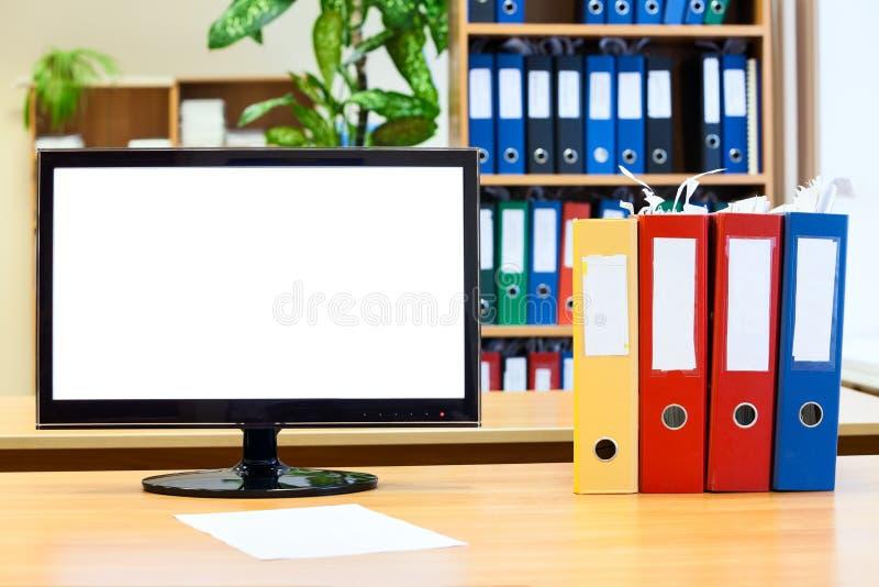 显示器屏幕和色的文件夹纸的 库存照片