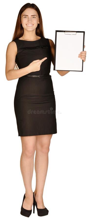 显示在剪贴板的女商人食指 库存图片