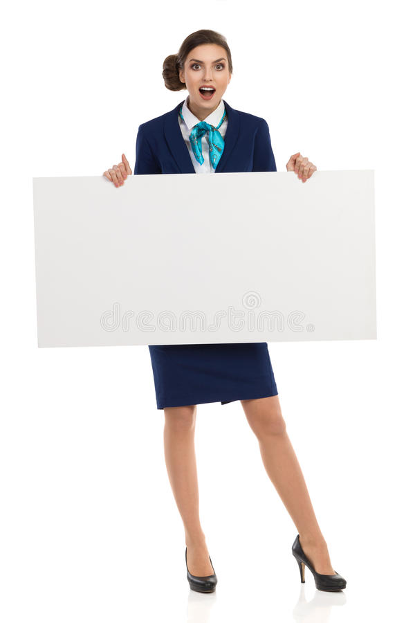 显示在横幅的惊奇的女实业家消息 库存照片