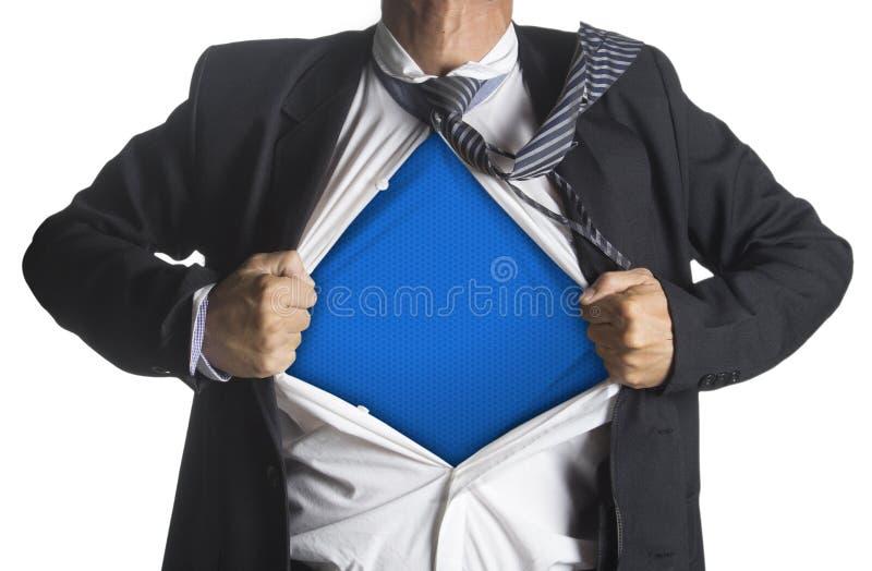 显示在他的衣服下的商人一套超级英雄衣服 免版税库存图片