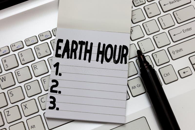 显示地球小时的文本标志 概念性呼吁的照片全球性运动对气候变化的更加巨大的行动 库存照片