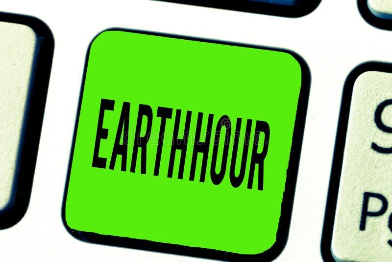 显示地球小时的文本标志 概念性呼吁的照片全球性运动对气候变化的更加巨大的行动 免版税库存图片