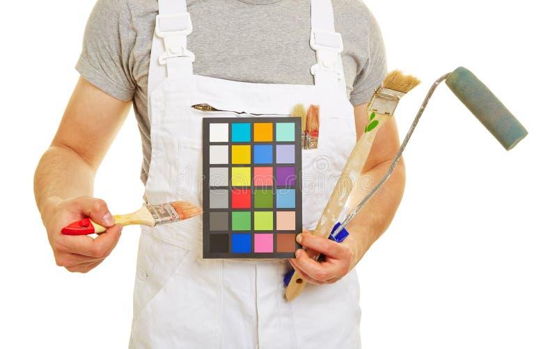 显示墙壁颜色celection的画家 图库摄影