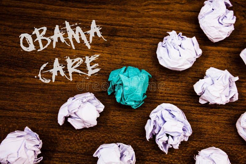 显示奥巴马关心的文字笔记 陈列保险系统患者ProtectionIdeas词的政府项目企业照片 免版税库存图片