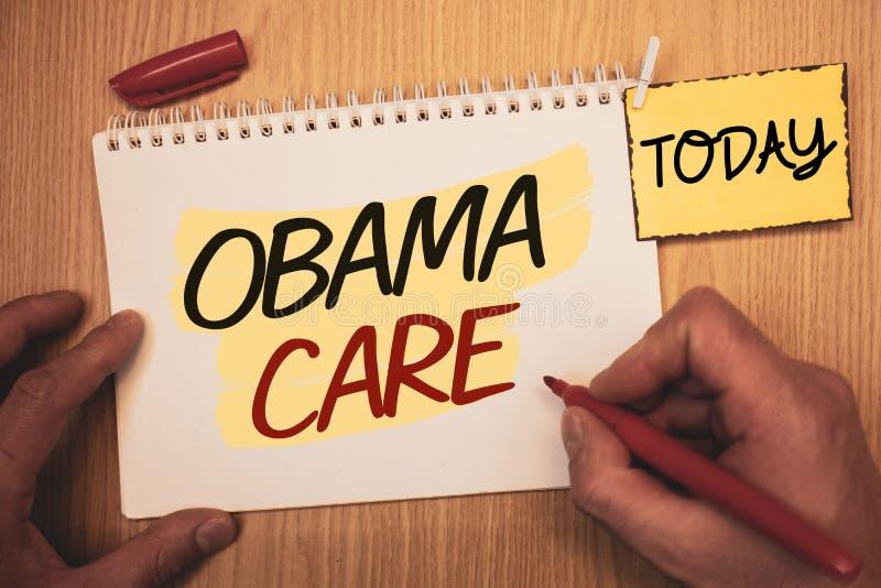 显示奥巴马关心的文本标志 保险系统患者创造的ProtectionMan概念性照片政府项目为今天  免版税库存图片