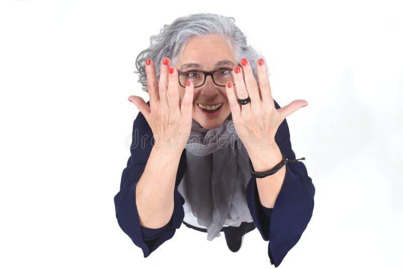显示她的被绘的指甲盖的妇女 免版税库存图片