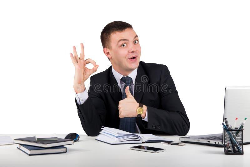 显示好标志的微笑的商人隔绝在白色背景 免版税图库摄影