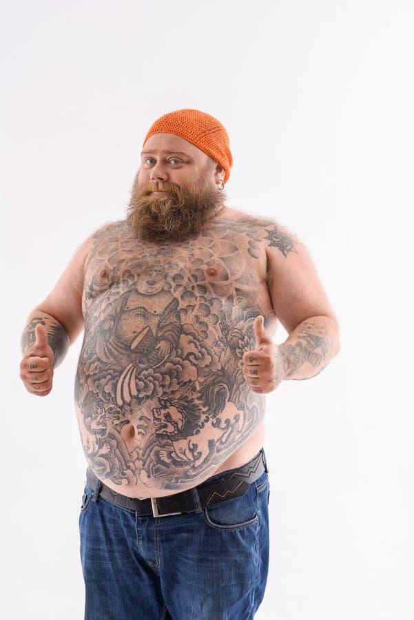 显示好标志的肥胖有胡子的人 库存照片