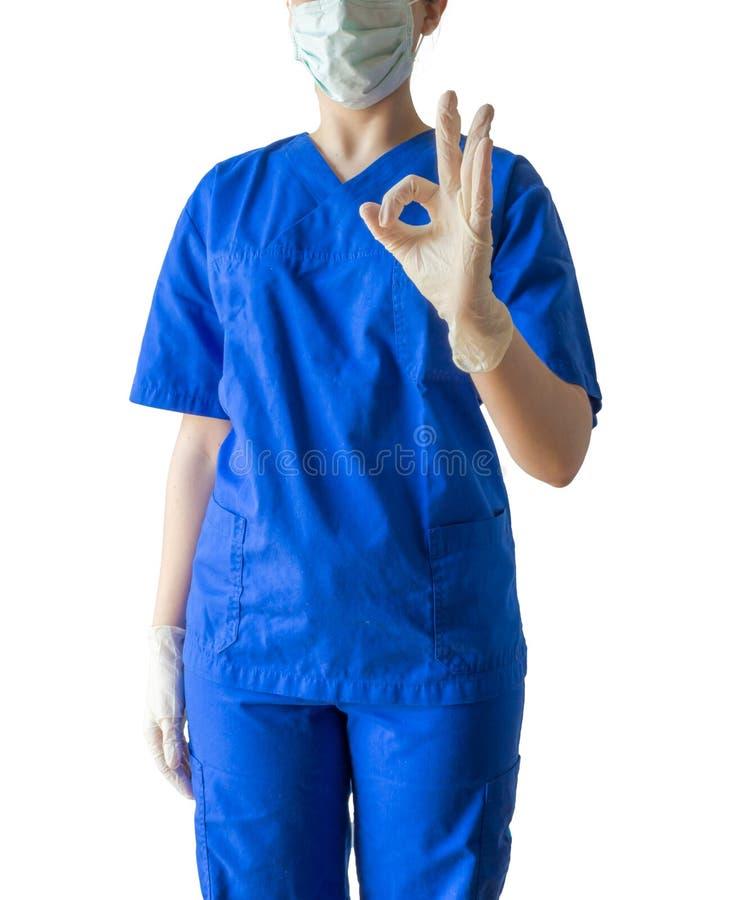 显示好s的蓝色医疗制服的未知的年轻女性医生 库存图片