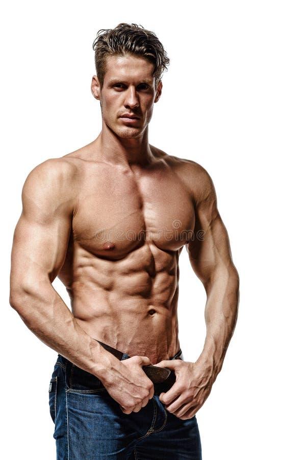 显示强健的身体和sixpack吸收的坚强的运动人 库存照片