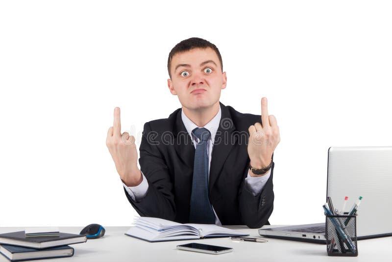 显示您中指的恼怒的商人 免版税图库摄影