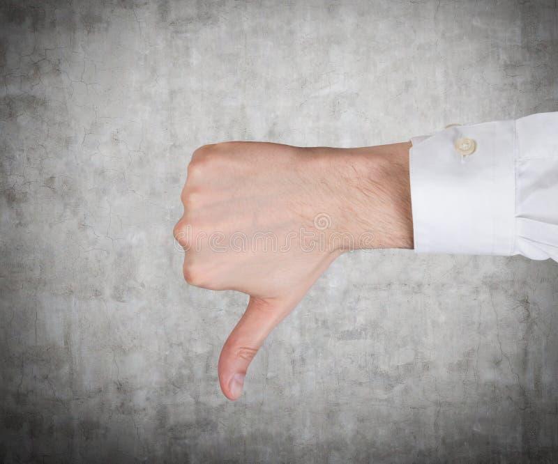 显示拇指的手下来 库存图片