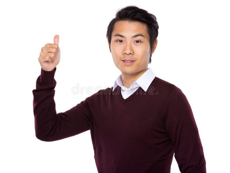 显示拇指年轻亚裔商人 免版税库存图片
