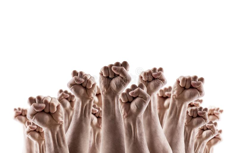 显示拳头的大小组被举的手 免版税图库摄影