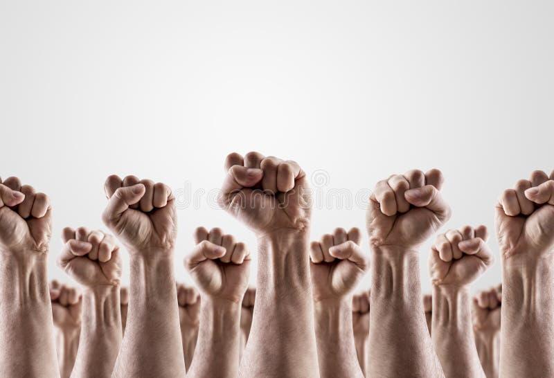 显示拳头的小组被举的手 免版税图库摄影