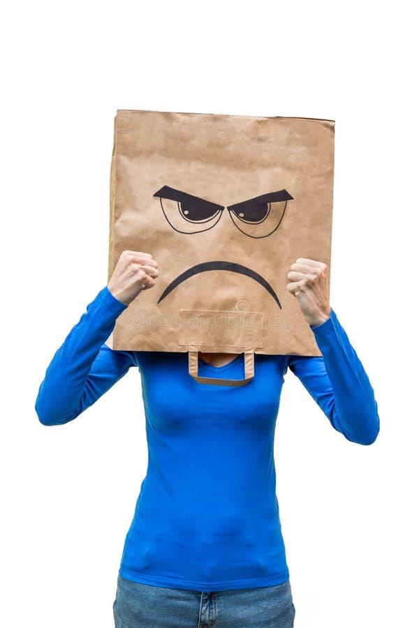 显示拳头的恼怒的妇女 库存图片