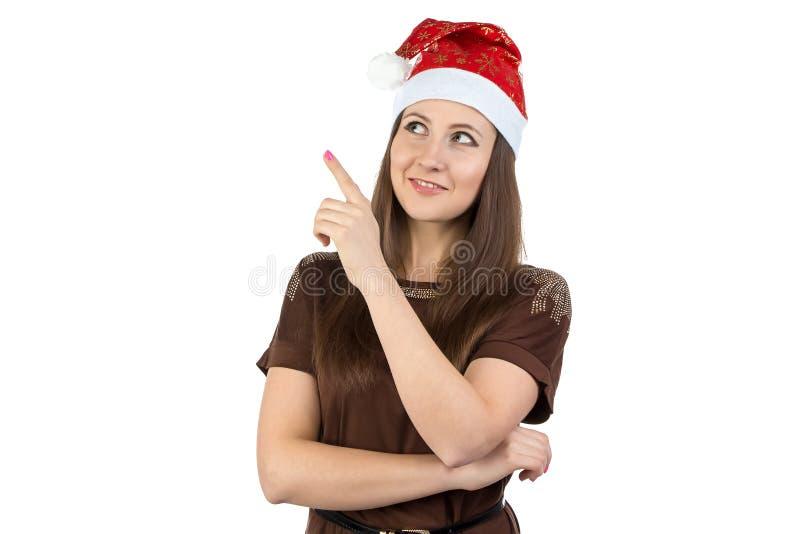 显示某事的少妇照片在xmas帽子 免版税图库摄影