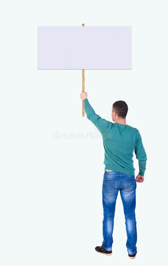 显示标志板的后面看法人 免版税库存图片