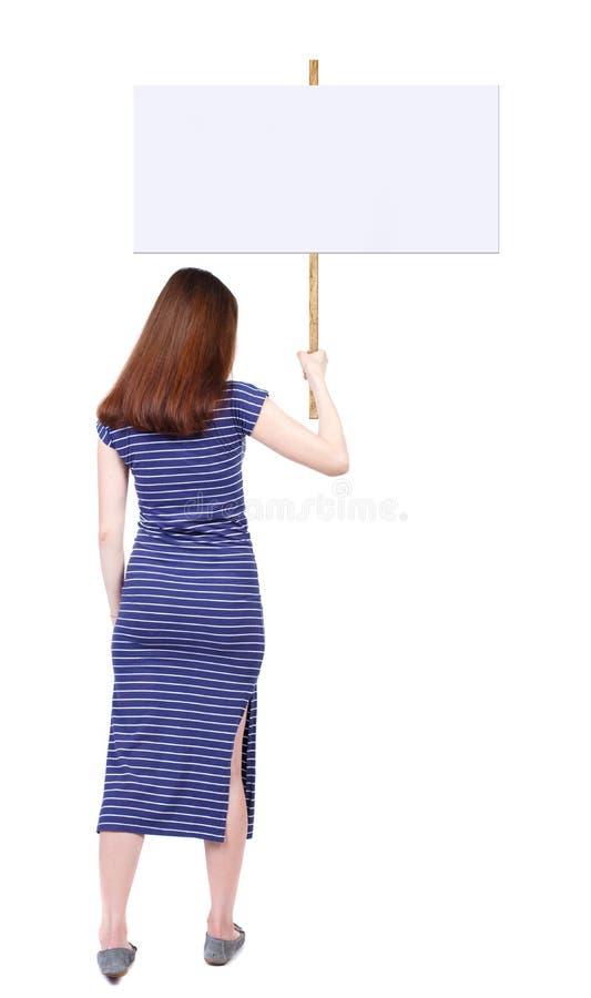 显示标志板的后面看法妇女 库存图片