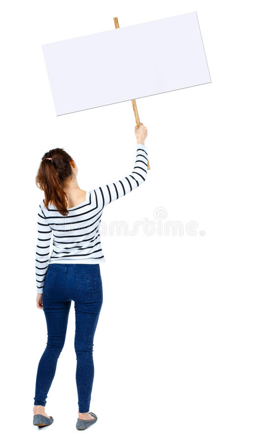 显示标志板的后面看法妇女 免版税图库摄影