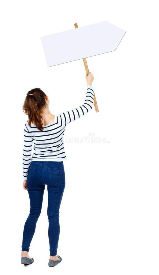 显示标志板的后面看法妇女 免版税库存图片